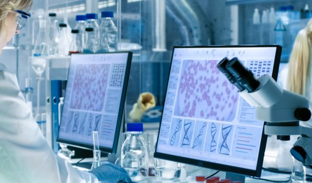 Woman behind screen in lab